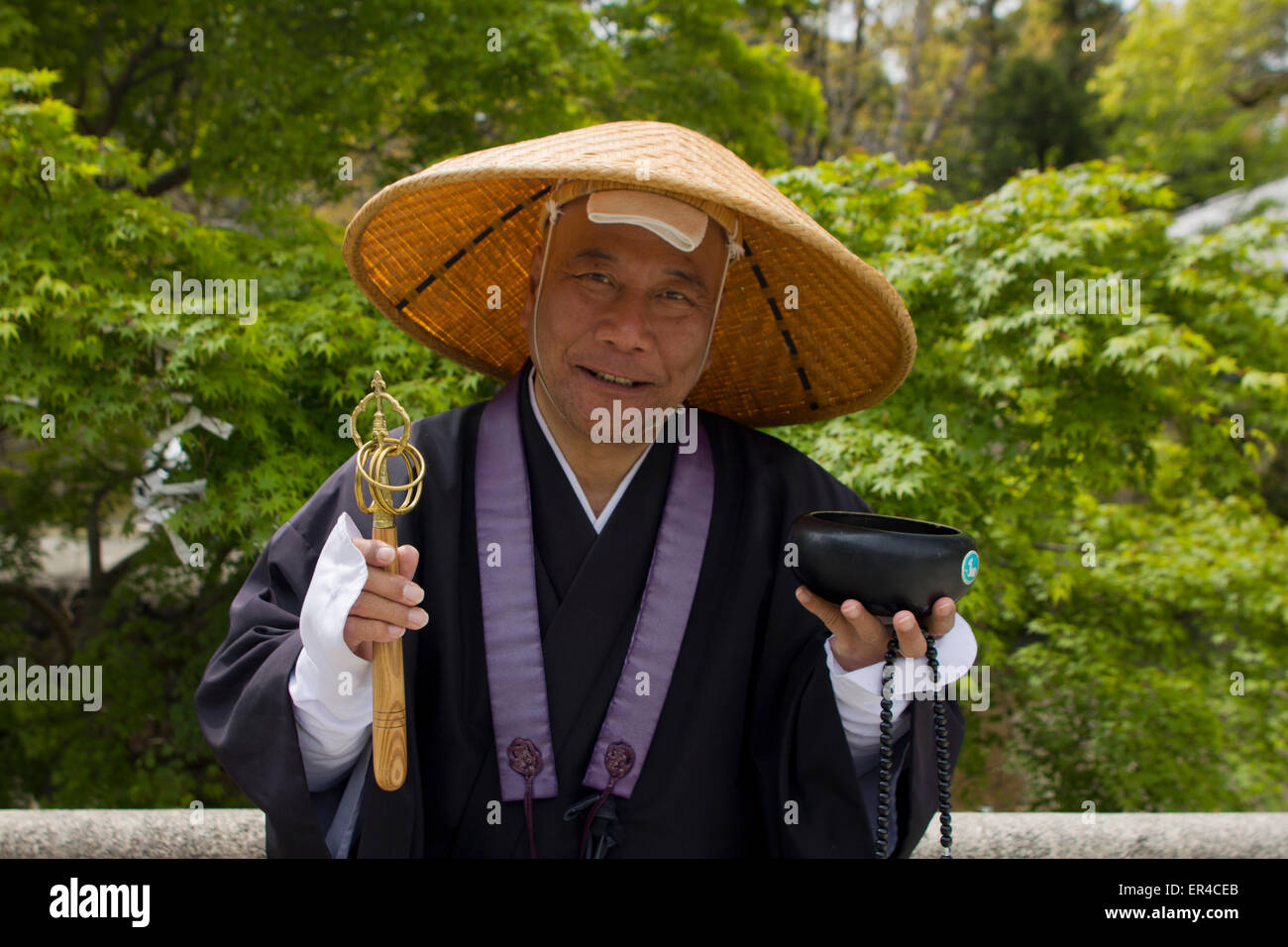 Japanese Buddhist monk collecting donations in Nara, Japan. - Stock Image