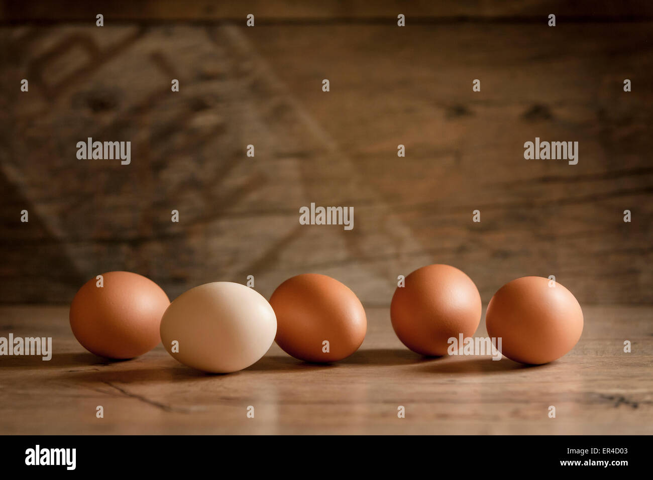 Eggs on a wooden table - Stock Image