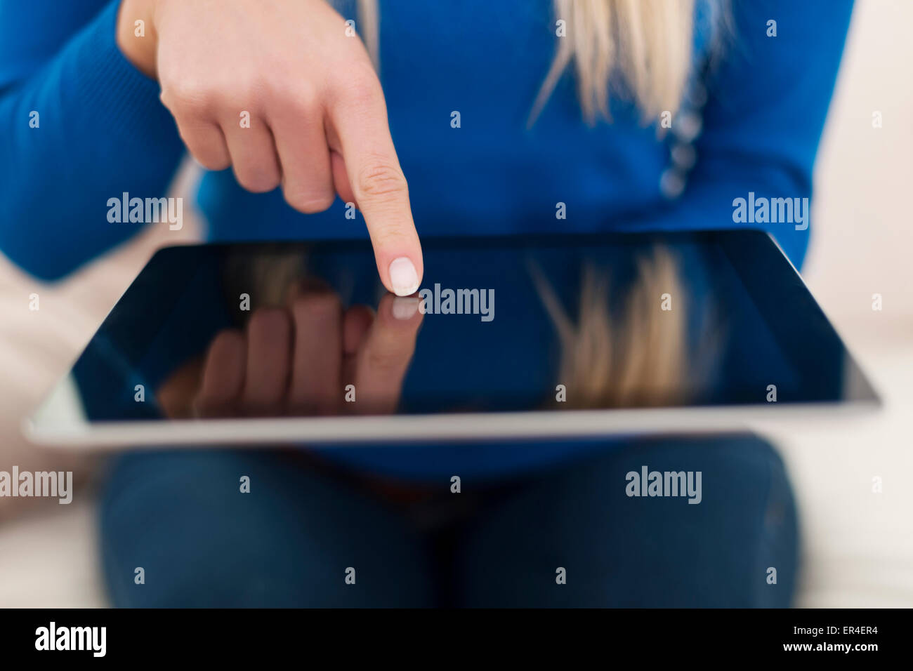 Close up of woman using digital tablet - Stock Image