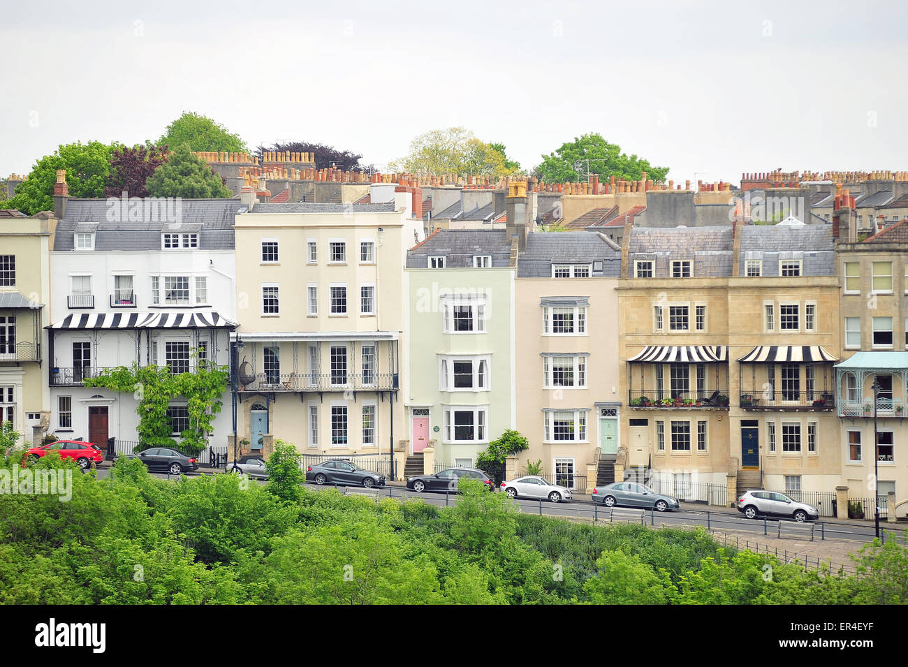 A row of terraced housing in Bristol that overlooks the Avon Gorge and the Clifton Suspension Bridge. - Stock Image