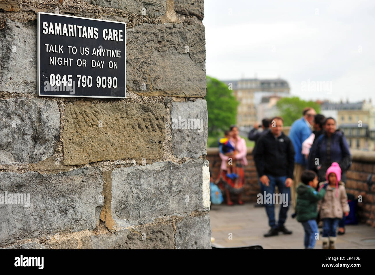 A Samaritans sign with a suicide helpline phone number on the edge of the Clifton Suspension Bridge in Bristol. Stock Photo