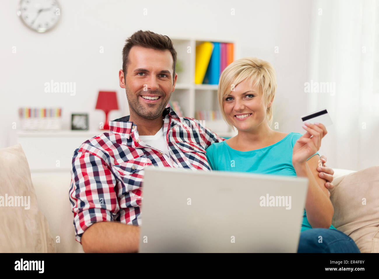 Young couple shopping online - Stock Image