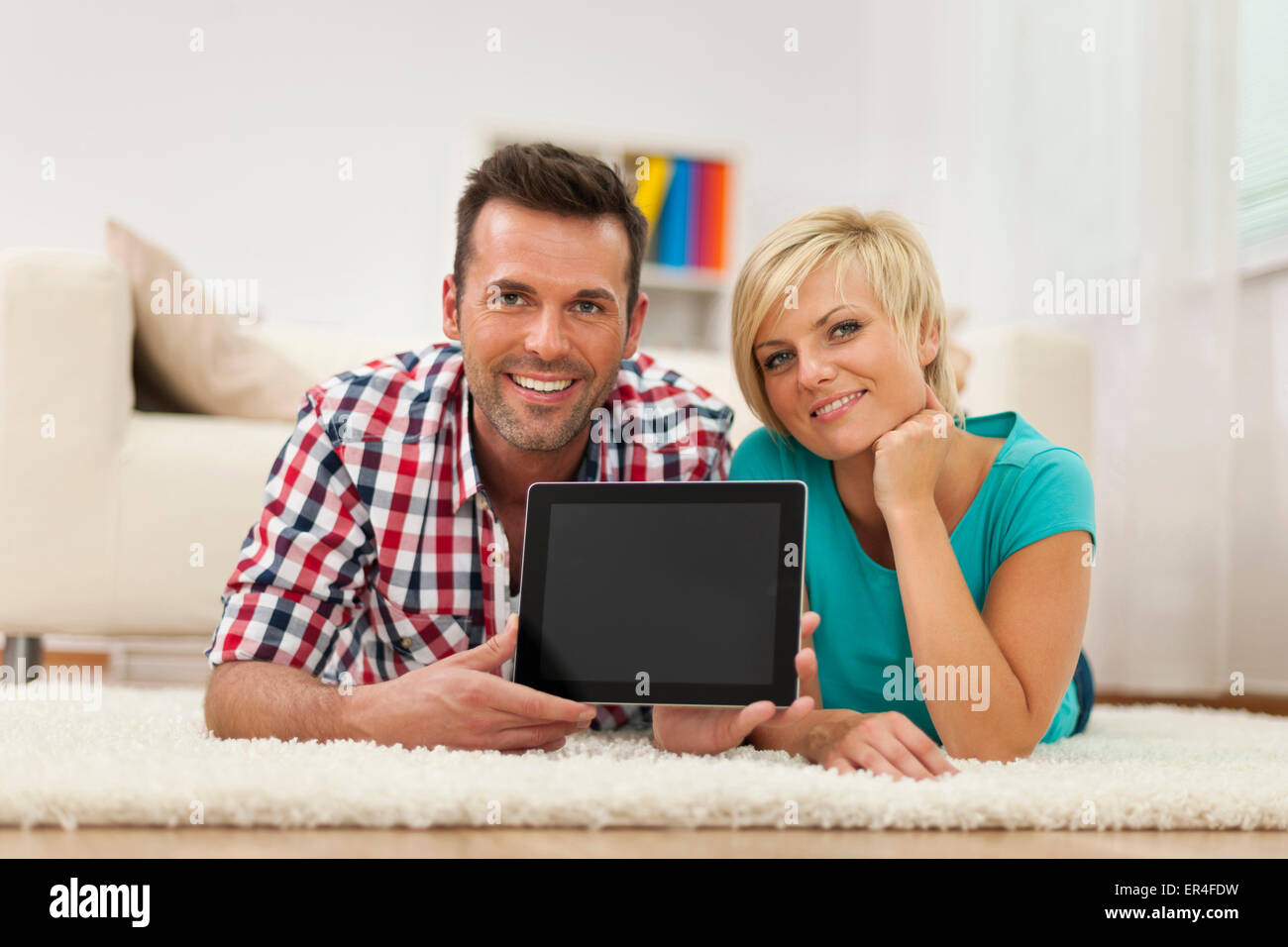 young couple with a digital tablet - Stock Image