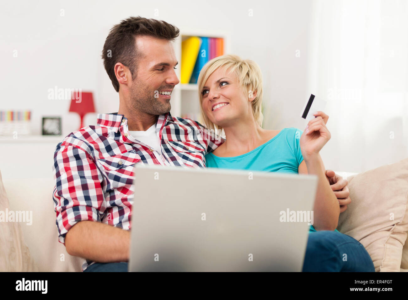 Couple shopping online together - Stock Image