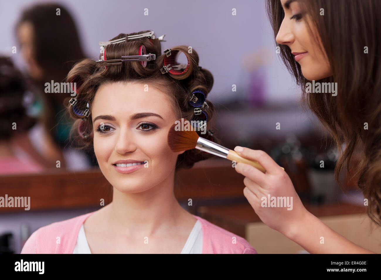 Makeup artist applying makeup by brush. Debica, Poland - Stock Image