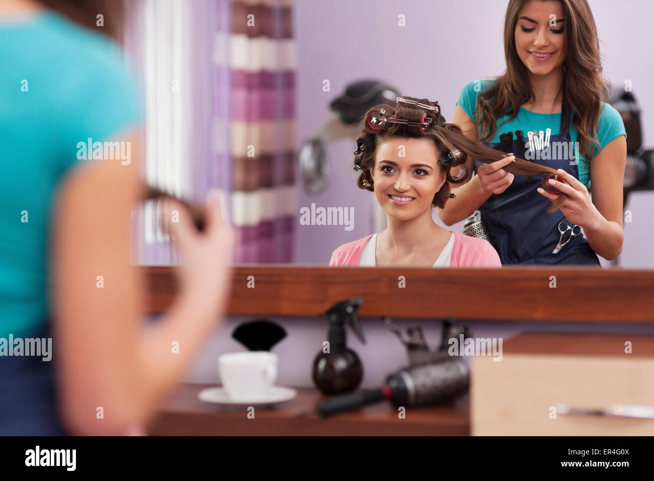 Visit at friendly hairdresser salon. Debica, Poland - Stock Image