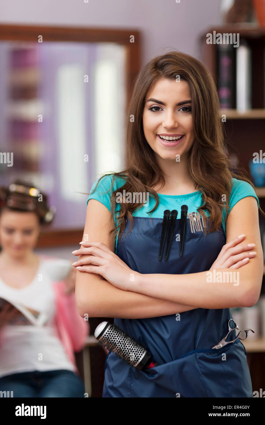 Smiling female owner of hairdresser salon. Debica, Poland - Stock Image