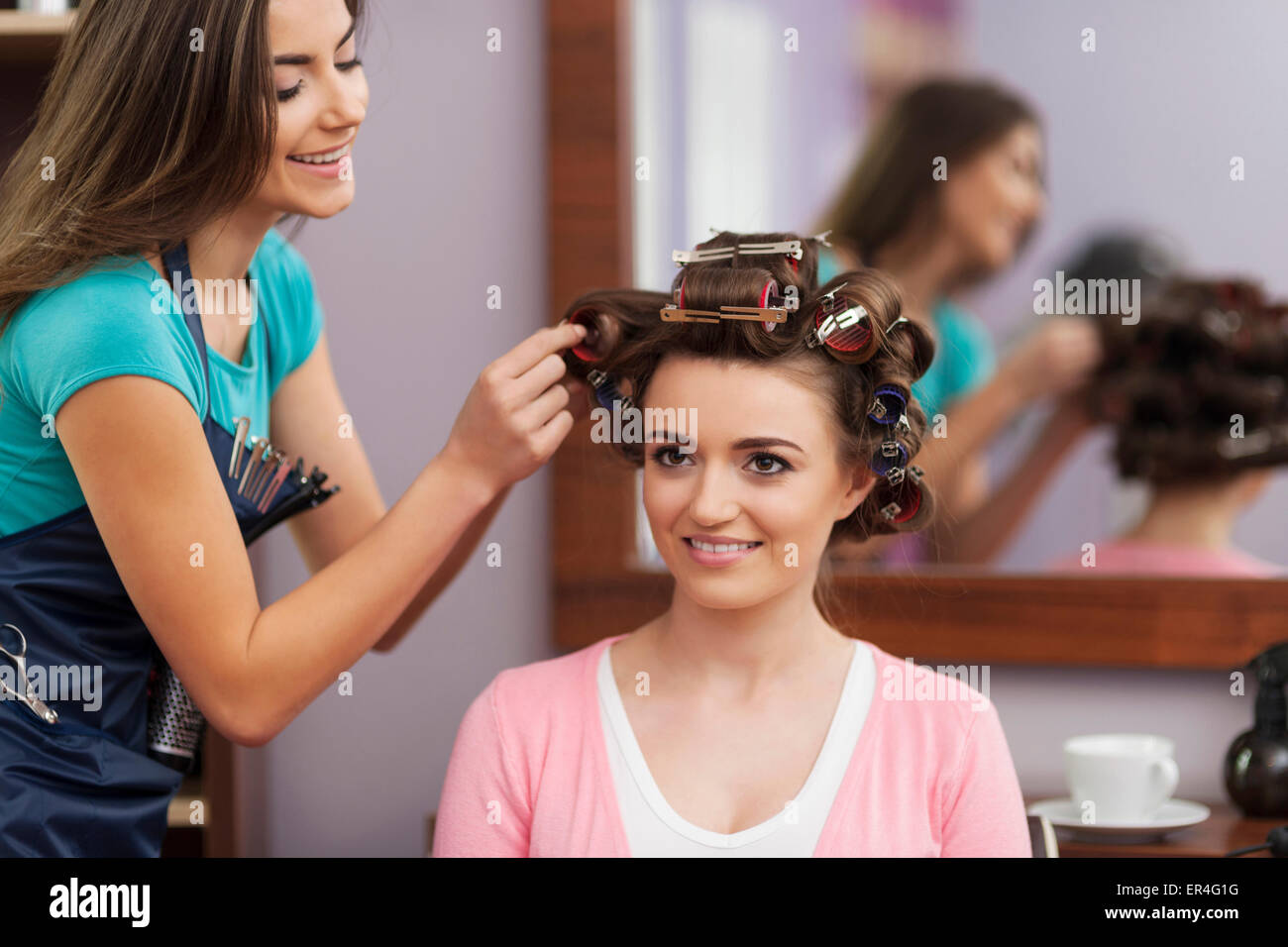 Creating trendy hairstyle by young woman. Debica, Poland - Stock Image