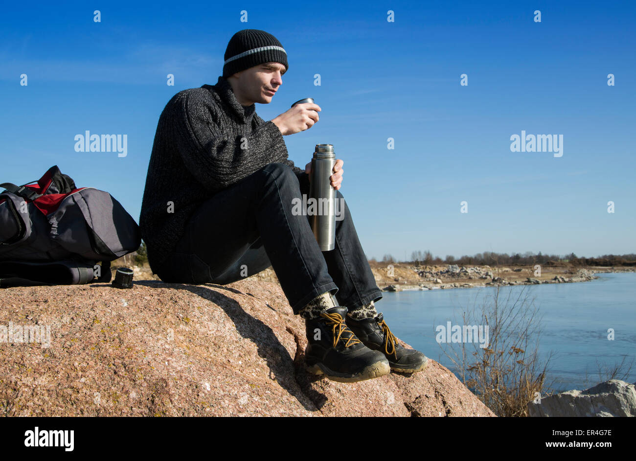 A traveler took a seat to rest - Stock Image