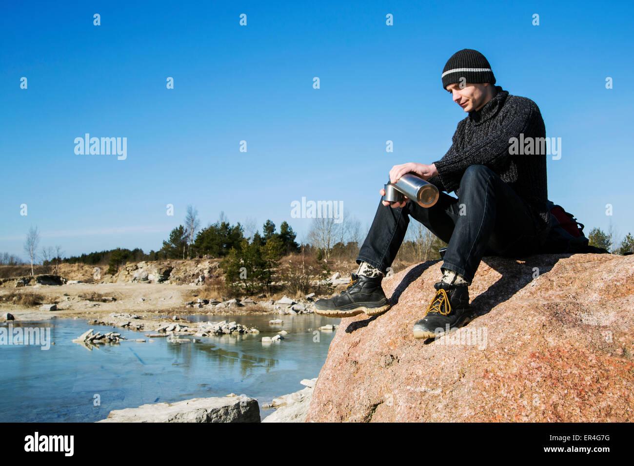 A male adventurer enjoying the sunny weather - Stock Image