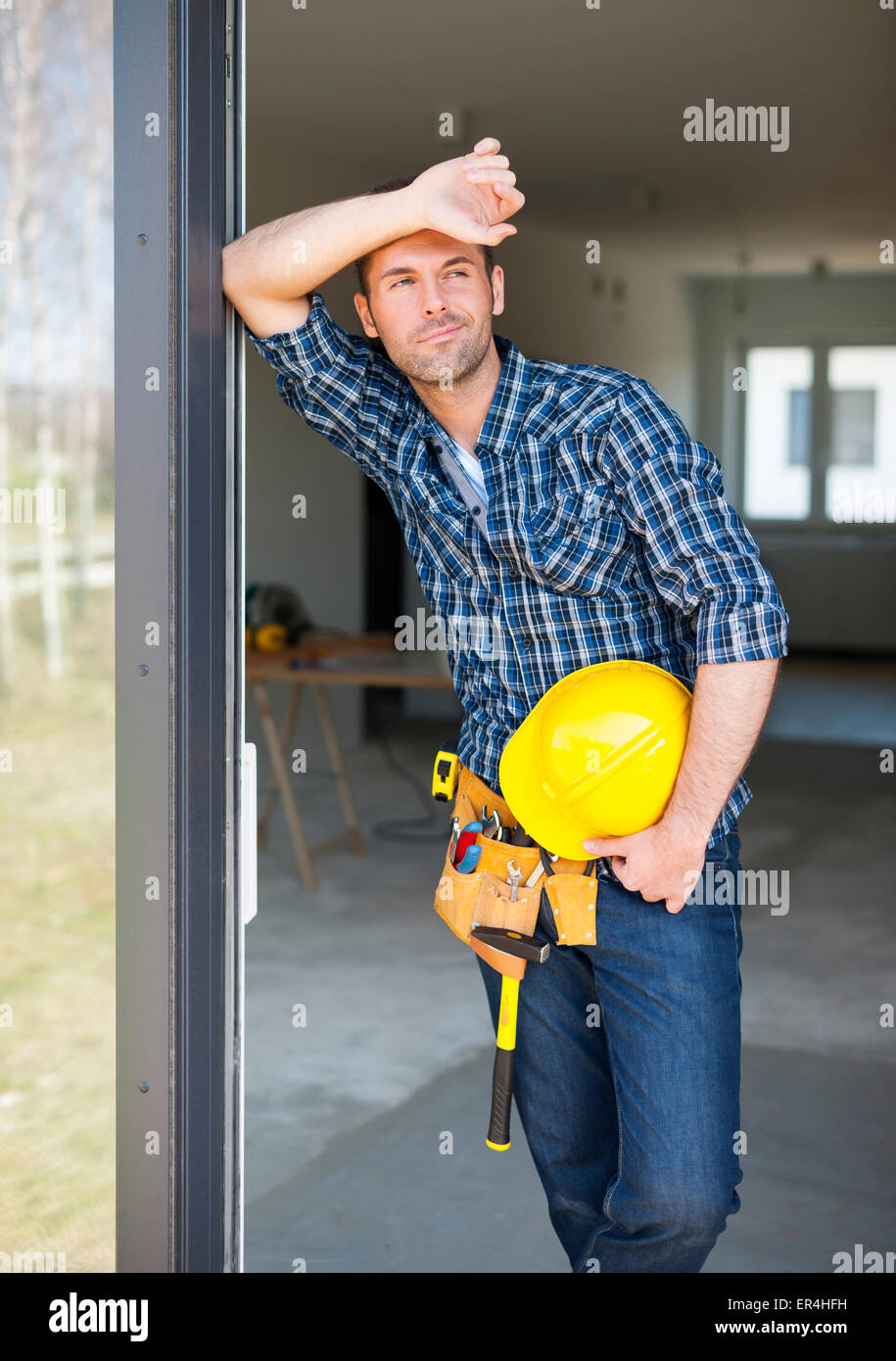 Construction worker relaxing the fresh air during work. Pilzno, Poland - Stock Image