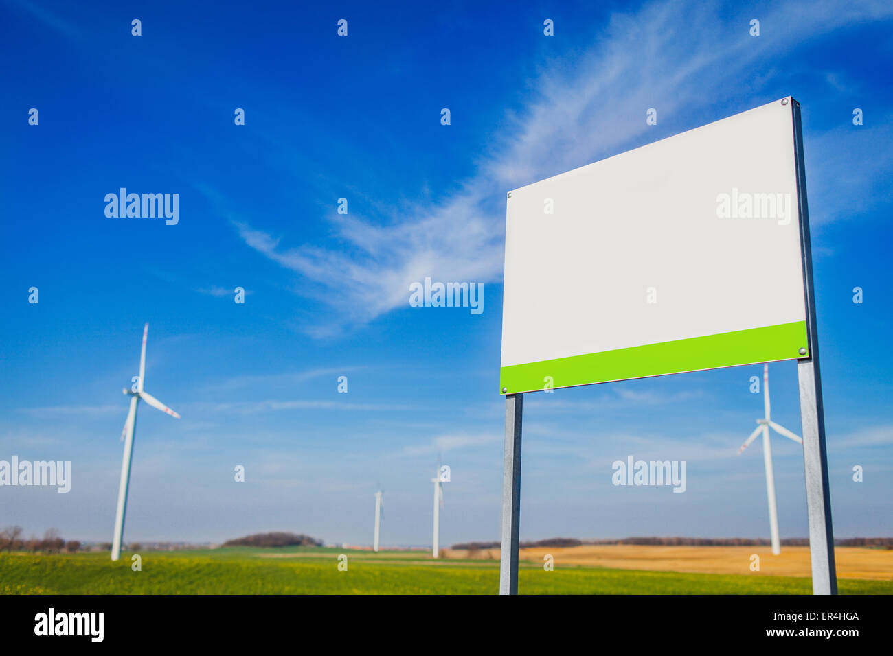 Blank board on area with energy windmills. Legnickie Pole, Poland - Stock Image