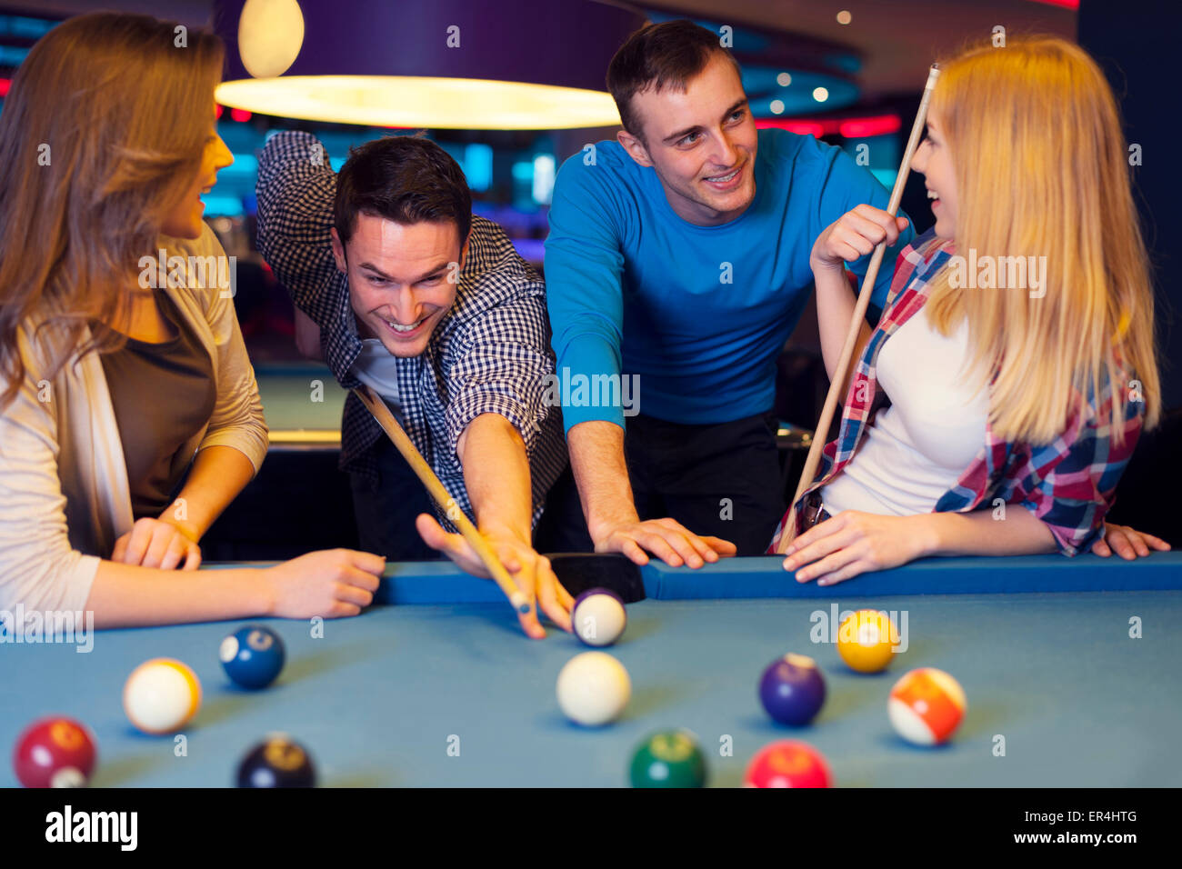 Friends hanging out at the bowling alley - Stock Image