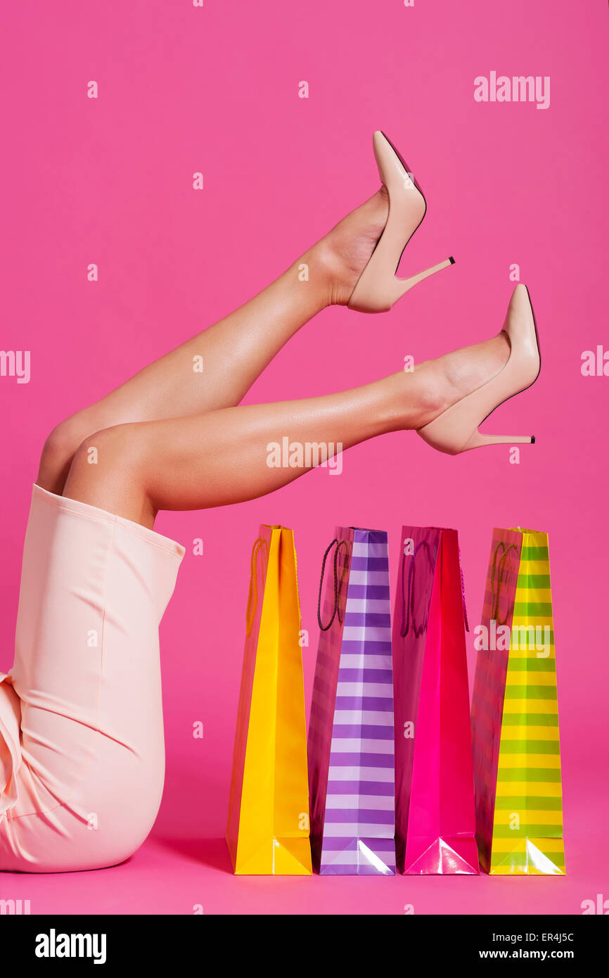 Beautiful woman with colorful shopping bags and high heels - Stock Image