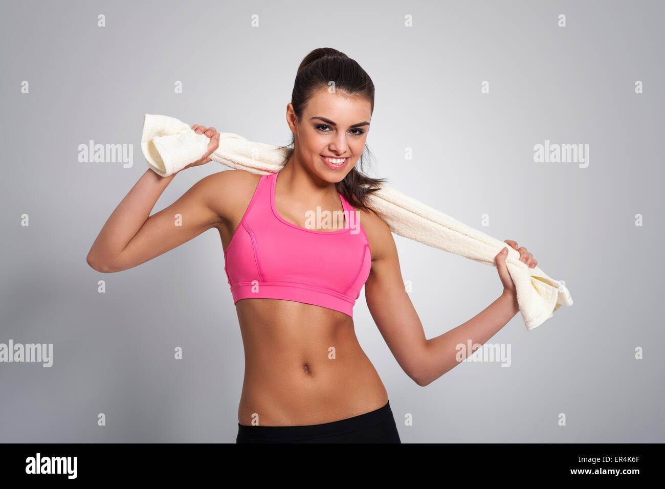 Portrait of beautiful fit woman with towel. Debica, Poland - Stock Image