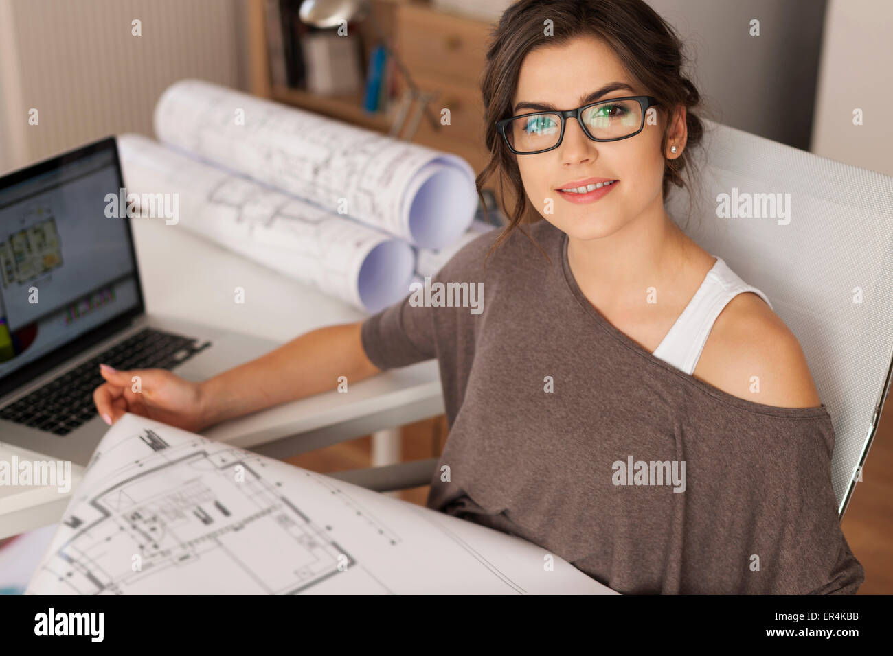 Young architect working in home office. Debica, Poland - Stock Image