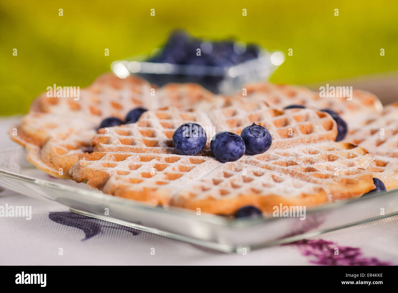 Sweet waffles for breakfast on wooden table. Debica, Poland - Stock Image