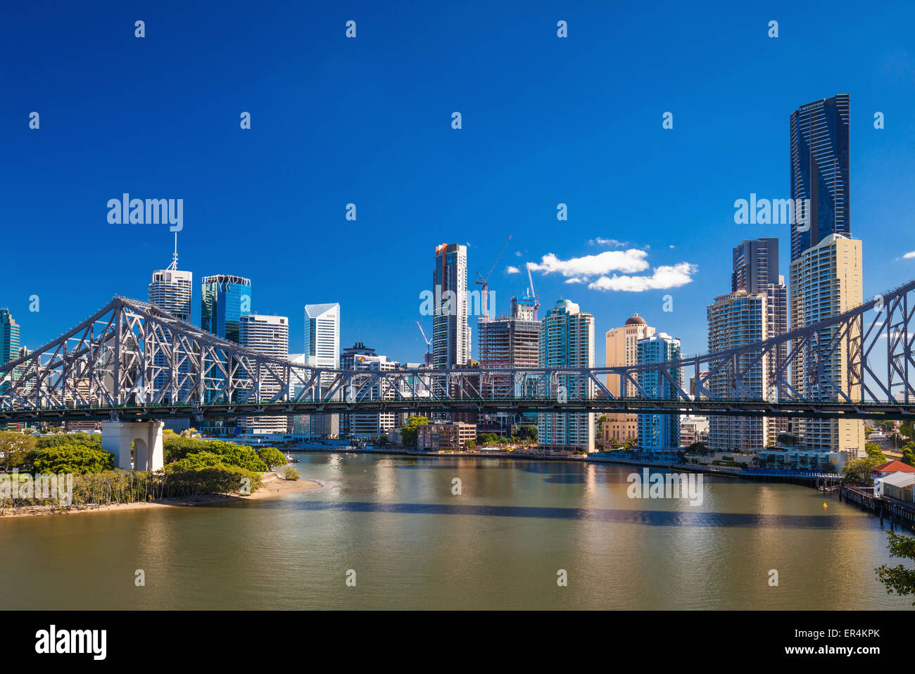 Ferry boat under Story Bridge with skyline of Brisbane, Queensland, Australia - Stock Image