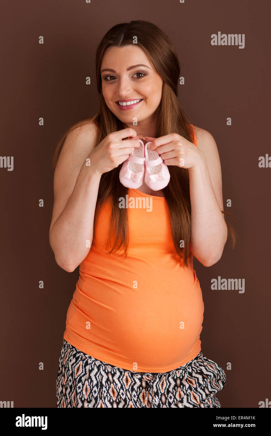 Beautiful woman with cute little shoes for girl. Debica, Poland Stock Photo