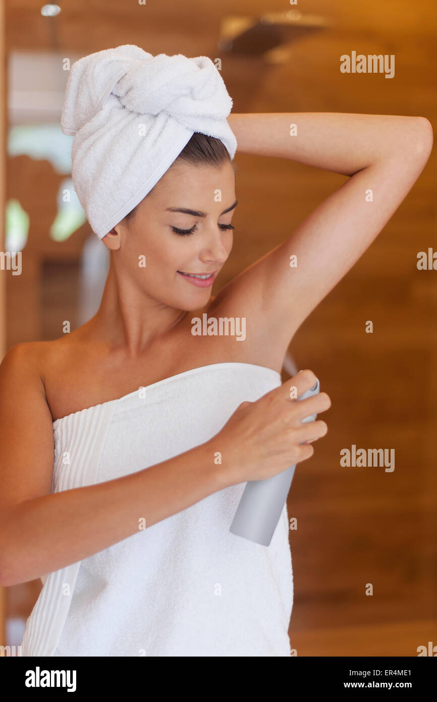 Beautiful woman using deodorant after the shower. Debica, Poland - Stock Image