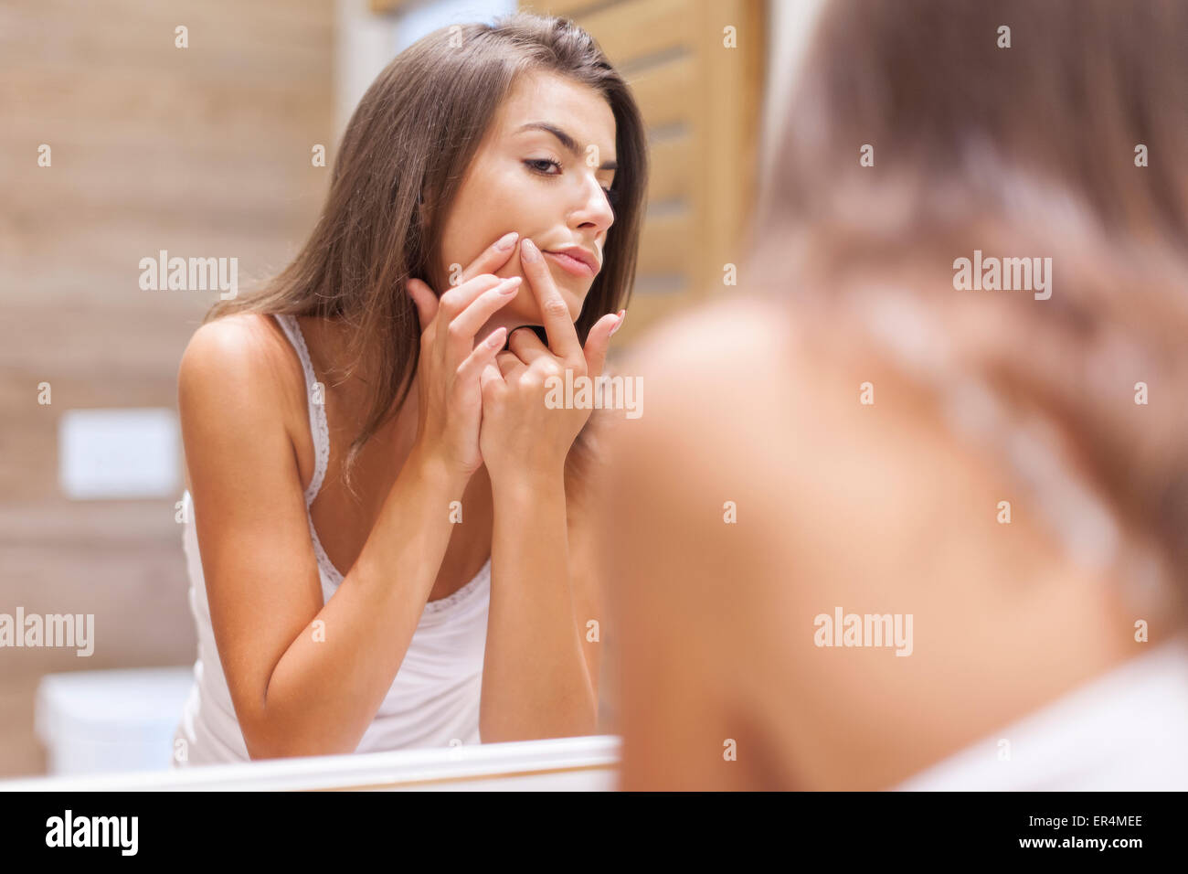 Young woman has problems with skin on the face. Debica, Poland - Stock Image