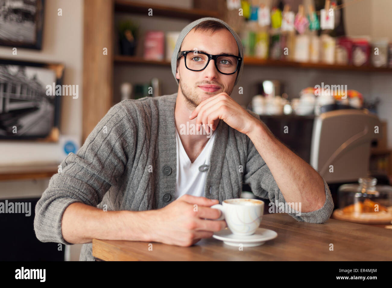 Portrait of stylish man at cafe. Krakow, Poland - Stock Image
