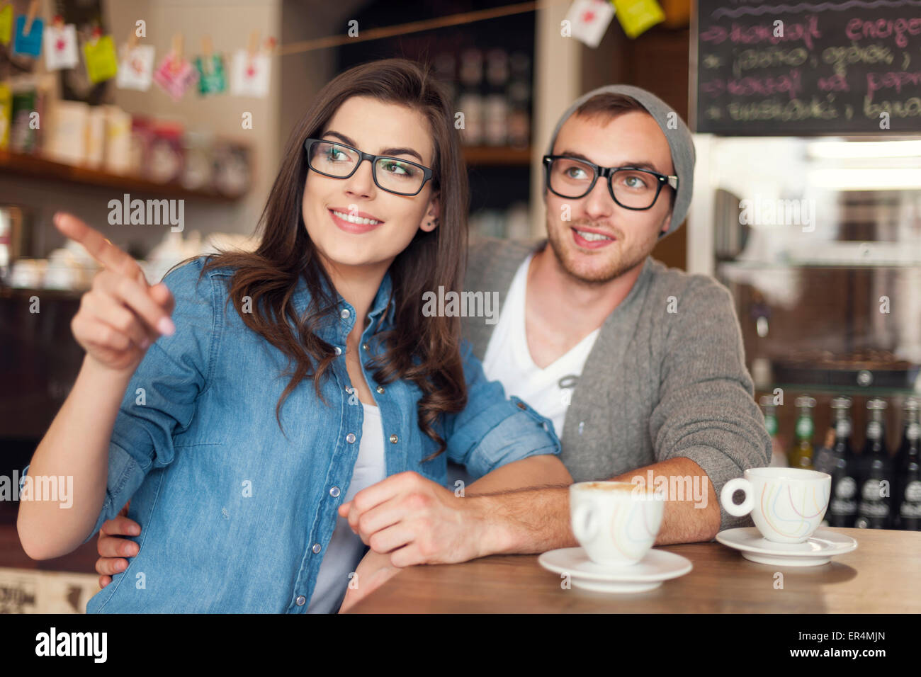 Hipster young couple at cafe. Krakow, Poland - Stock Image