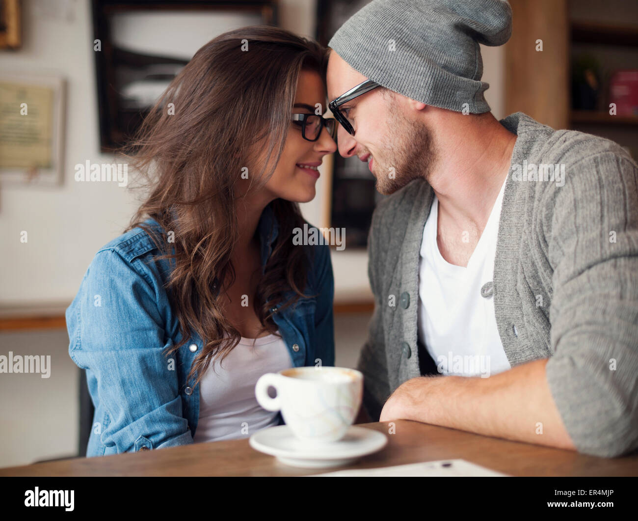 Portrait of loving couple at cafe. Krakow, Poland - Stock Image