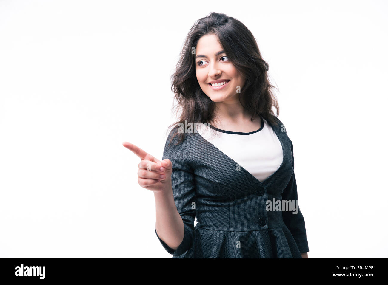 Happy businesswoman pointing finger away isolated on a white background - Stock Image