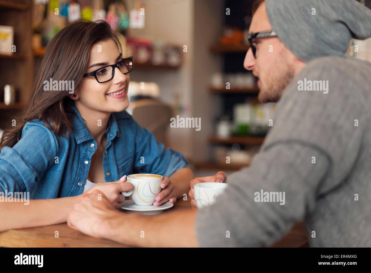 Loving couple on date at cafe. Krakow, Poland - Stock Image