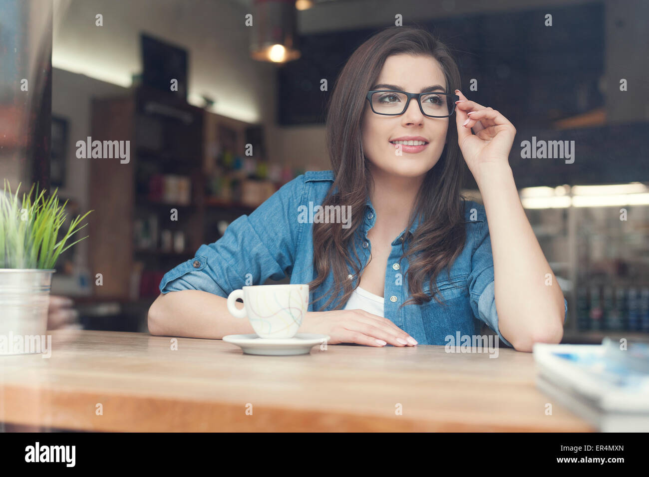 Portrait of beautiful woman at cafe. Krakow, Poland - Stock Image