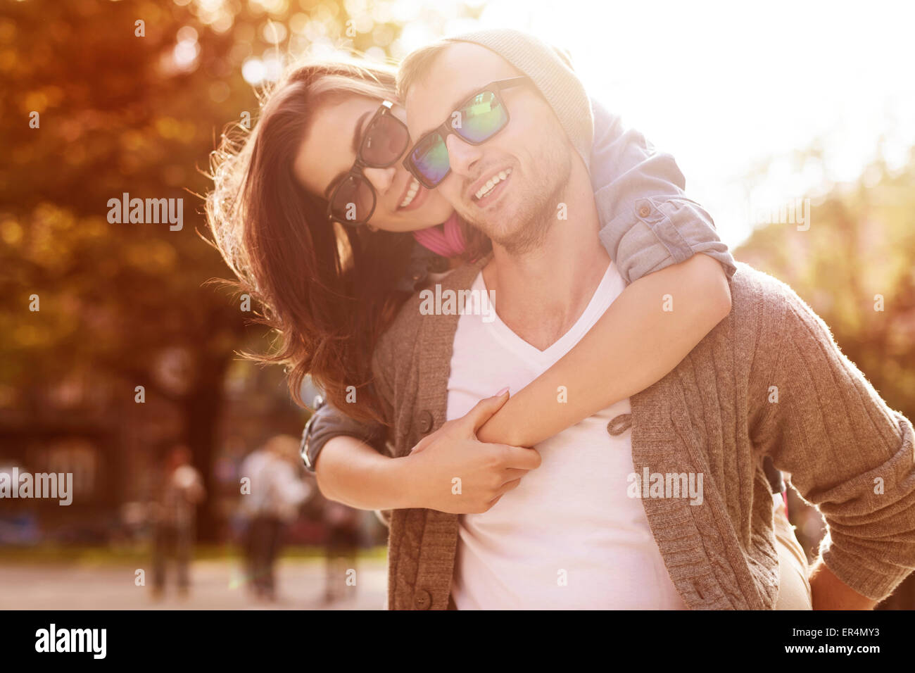 Young couple have fun in sunny day. Krakow, Poland Stock Photo