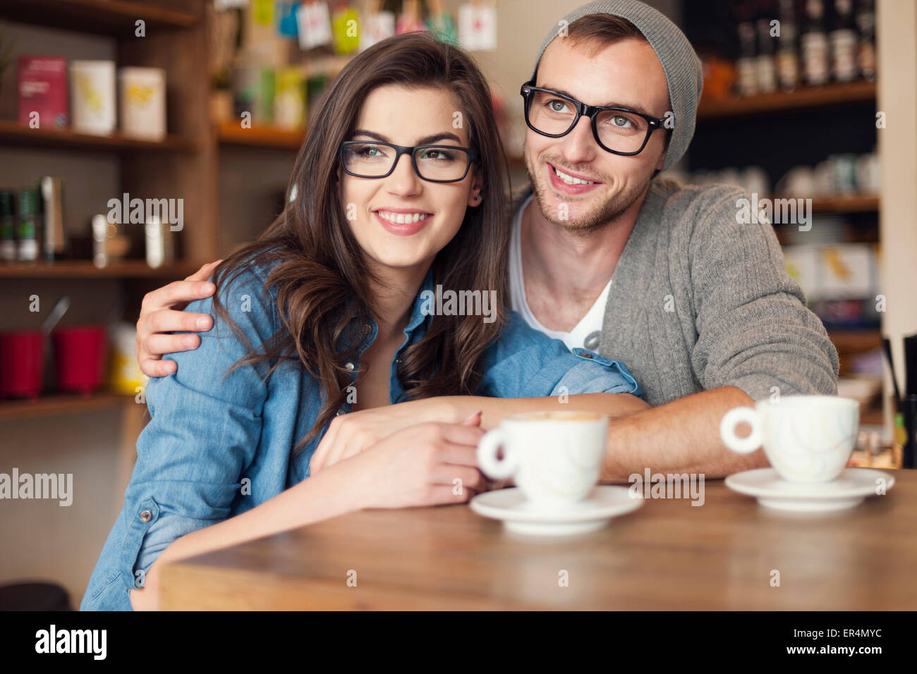 Embracing couple spending together at cafe. Krakow, Poland - Stock Image