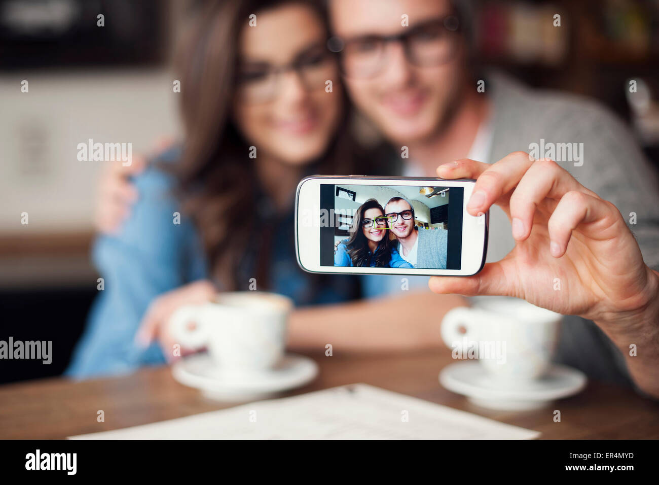 Loving couple taking selfie at cafe. Krakow, Poland Stock Photo