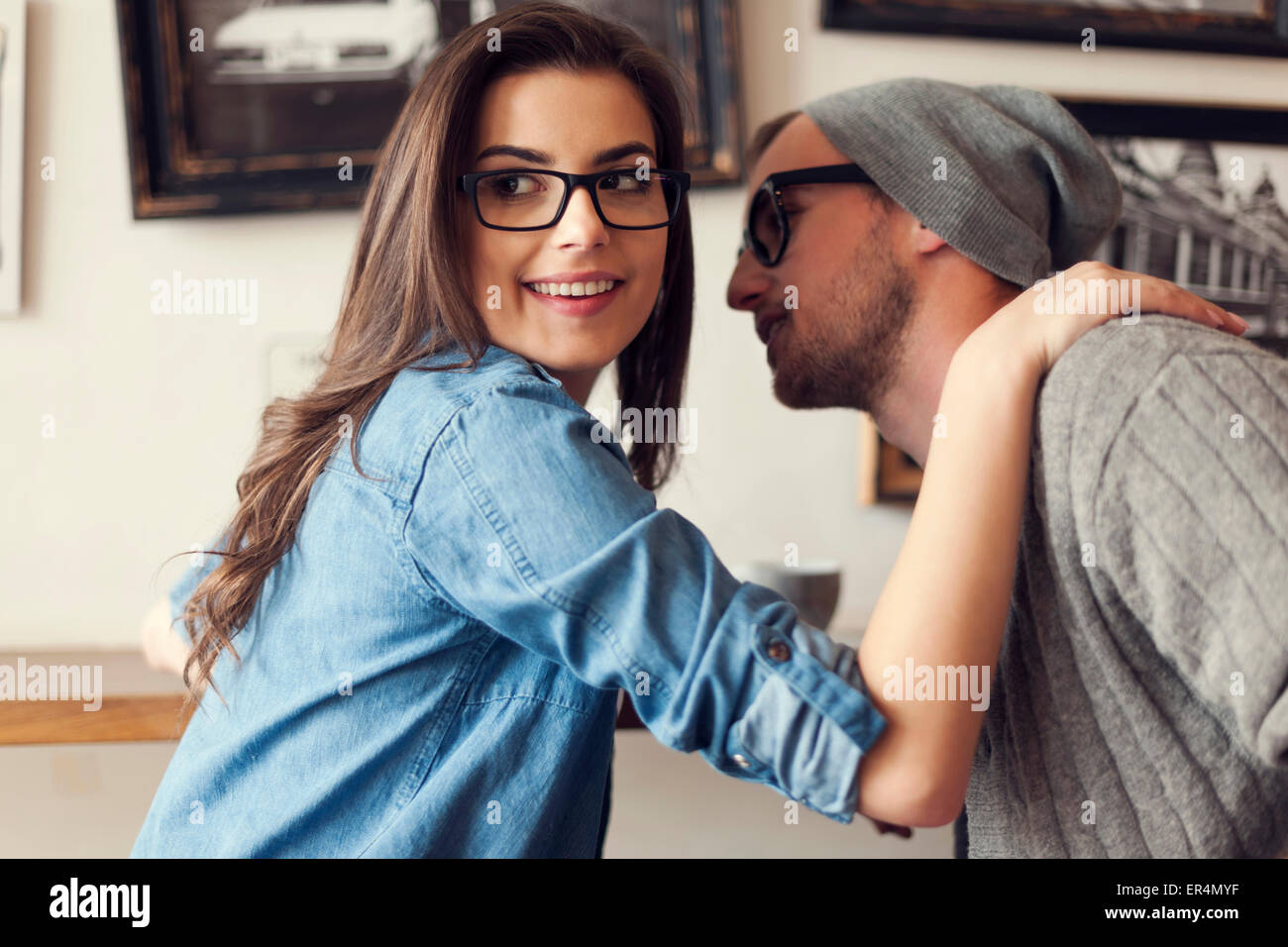 Hipster couple flirting at cafe. Krakow, Poland - Stock Image