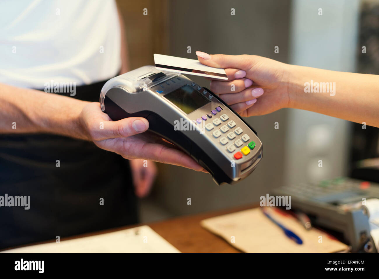 Close up of customer paying by credit card. Krakow, Poland Stock Photo