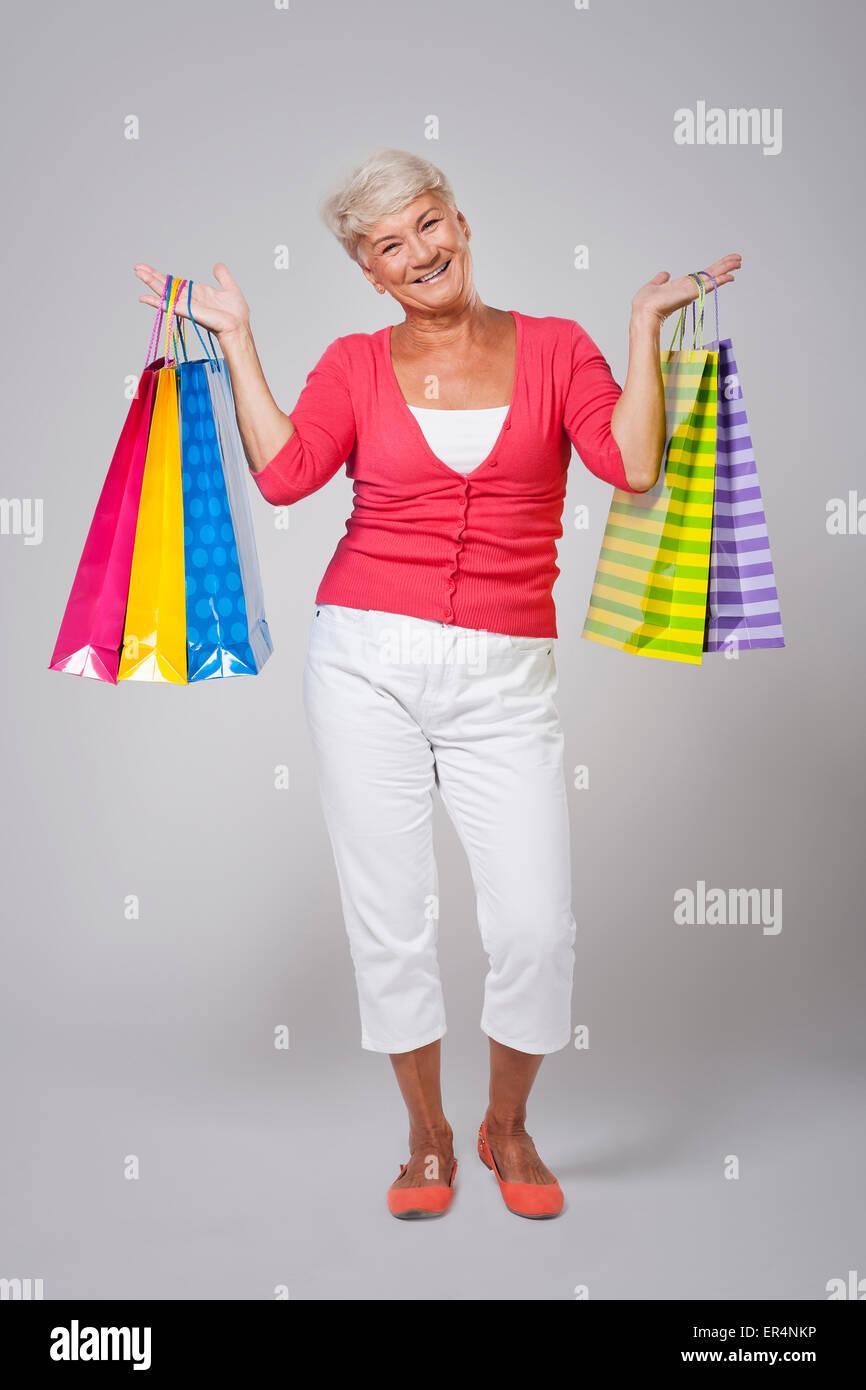 Older lady loves shopping - Stock Image