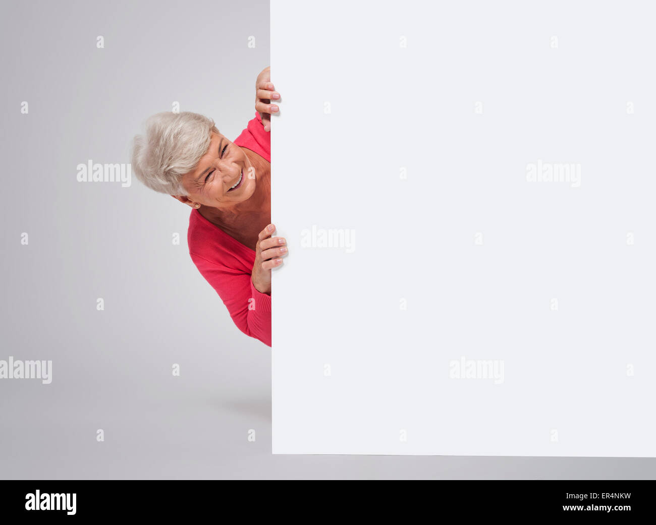 Older lady holding a caption board - Stock Image
