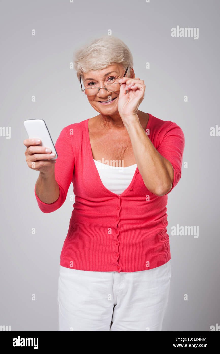 Older lady with a cellphone - Stock Image