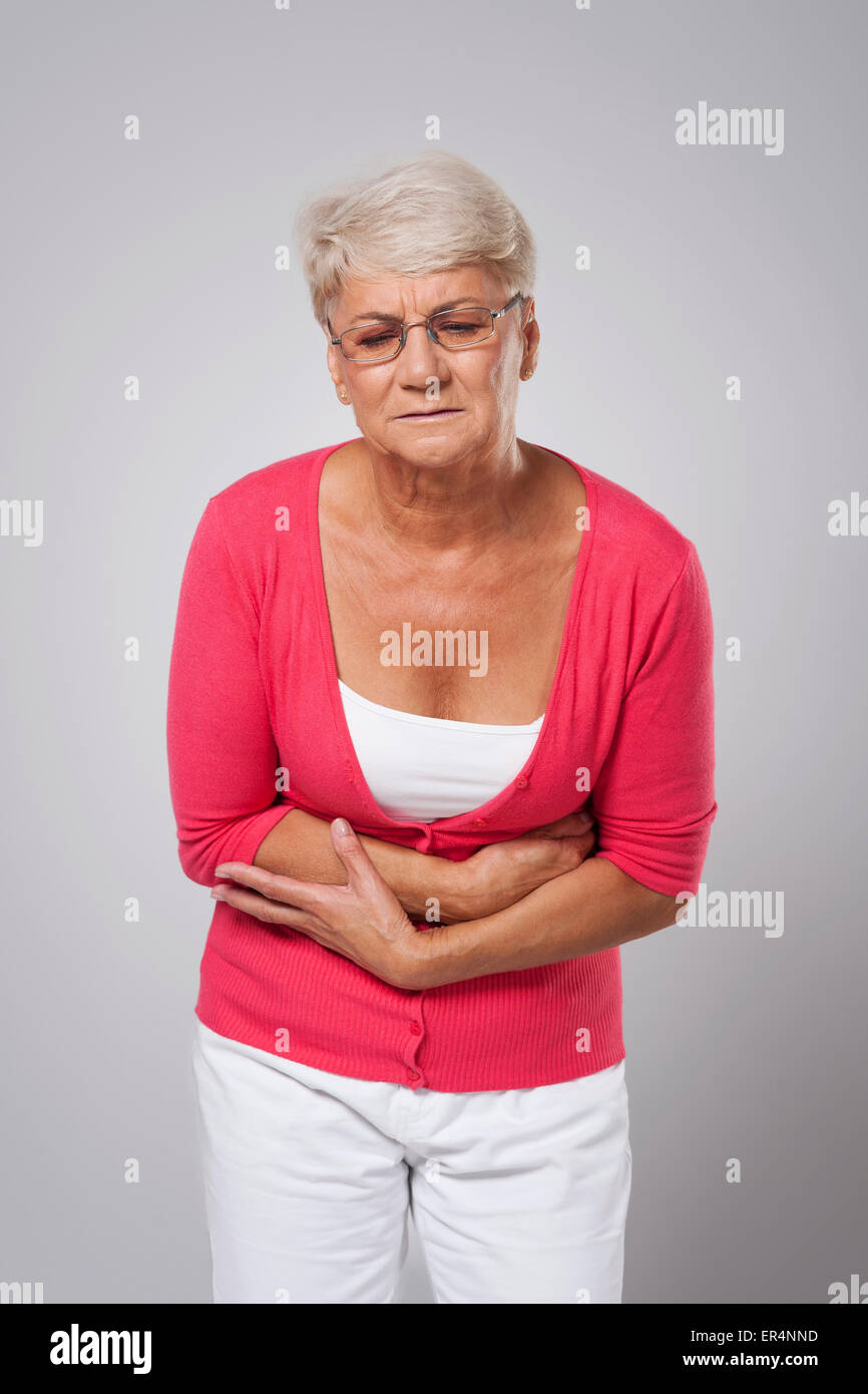Lady with stomach ache - Stock Image