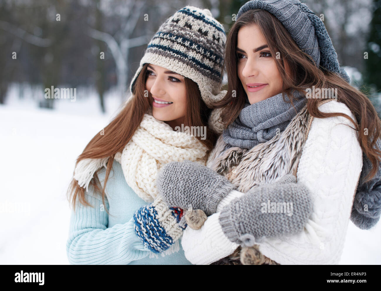 Warmed by friendship in winter. Debica, Poland - Stock Image