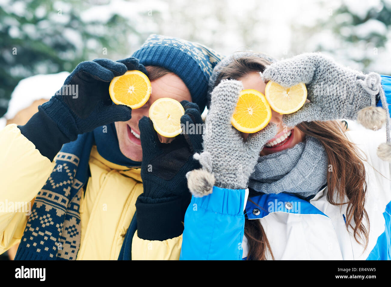 Couple have fun with natural vitamins in winter. Debica, Poland - Stock Image