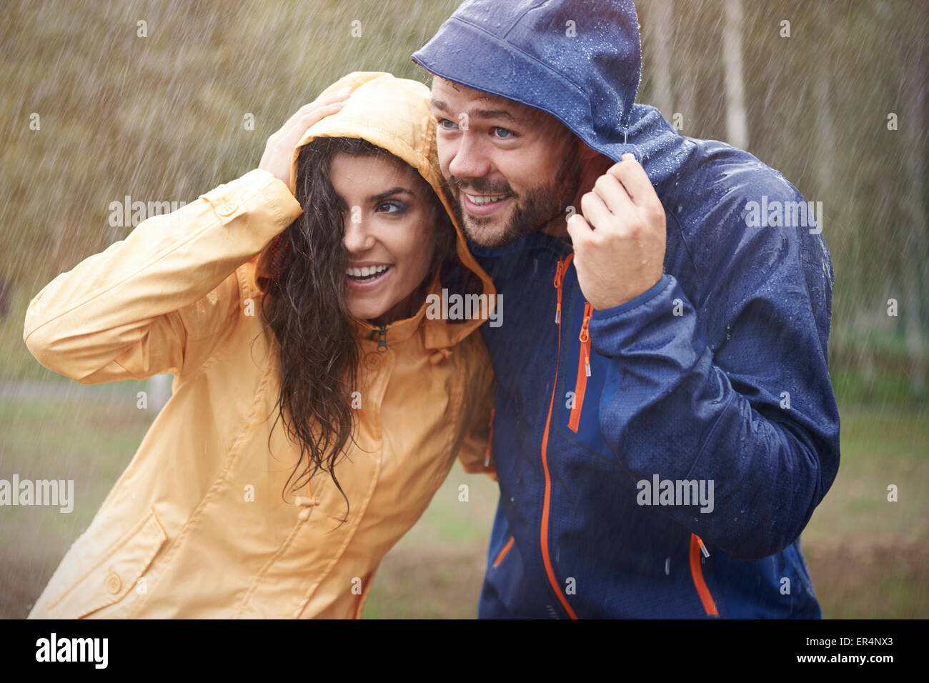 Quick! We have to run it started to rain. Debica, Poland - Stock Image