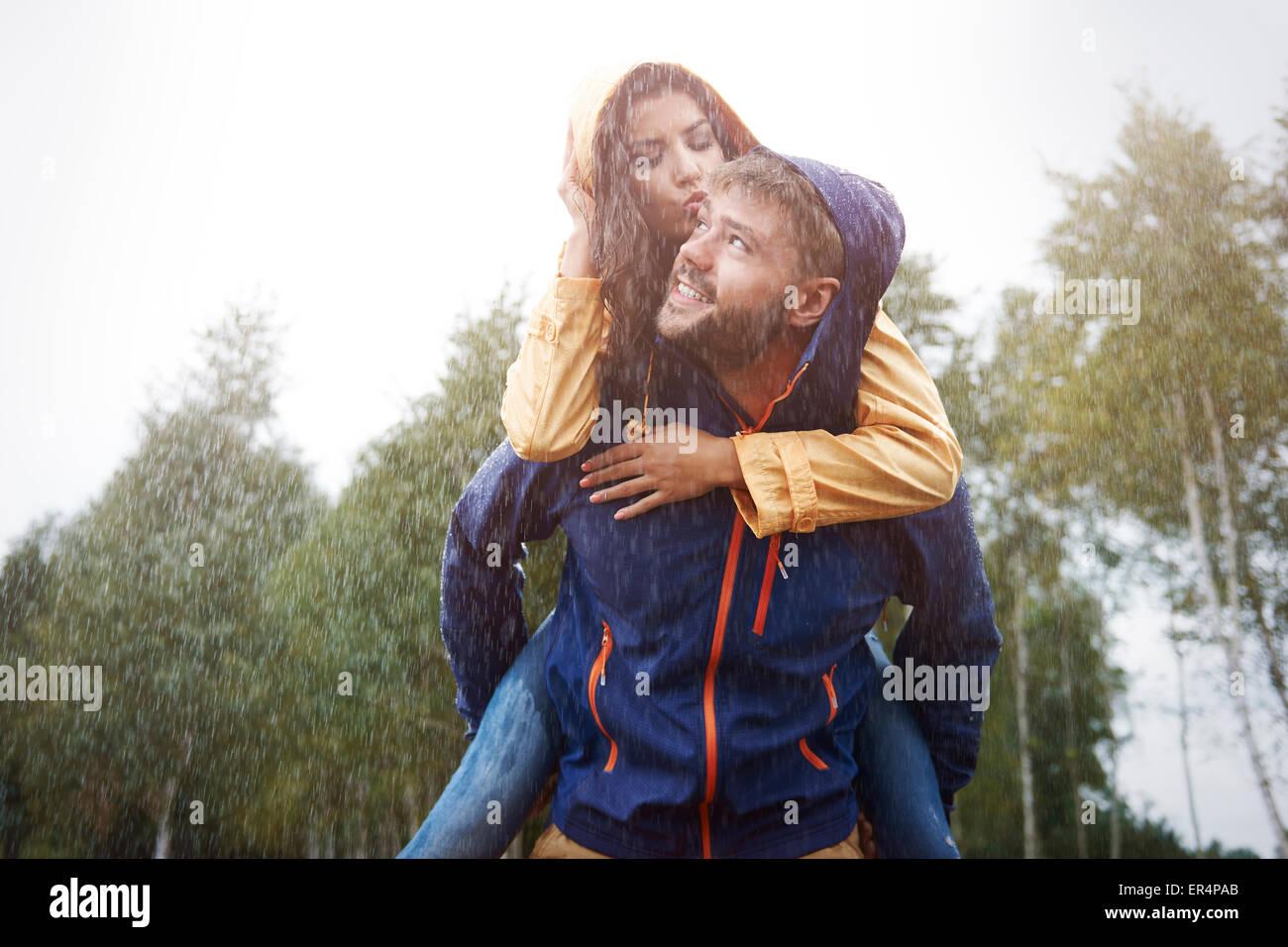 Happy time for loving couple in rain. Debica, Poland - Stock Image