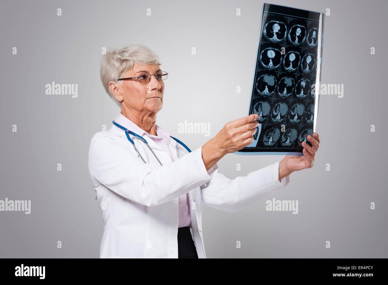 Focus senior woman analyzing test result. Debica, Poland - Stock Image