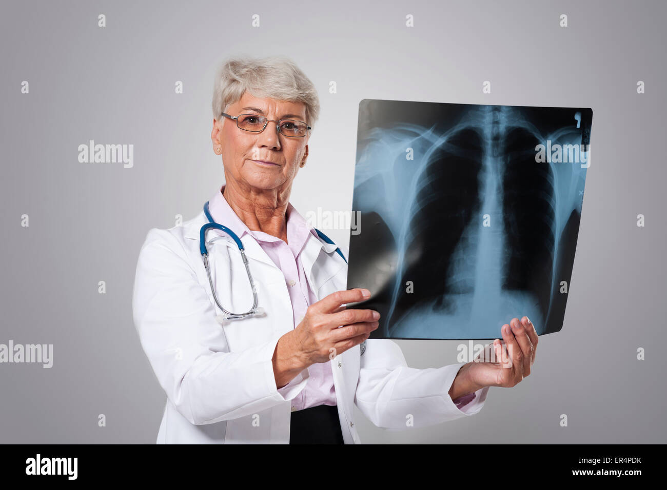 Serious senior doctor with medical test. Debica, Poland - Stock Image