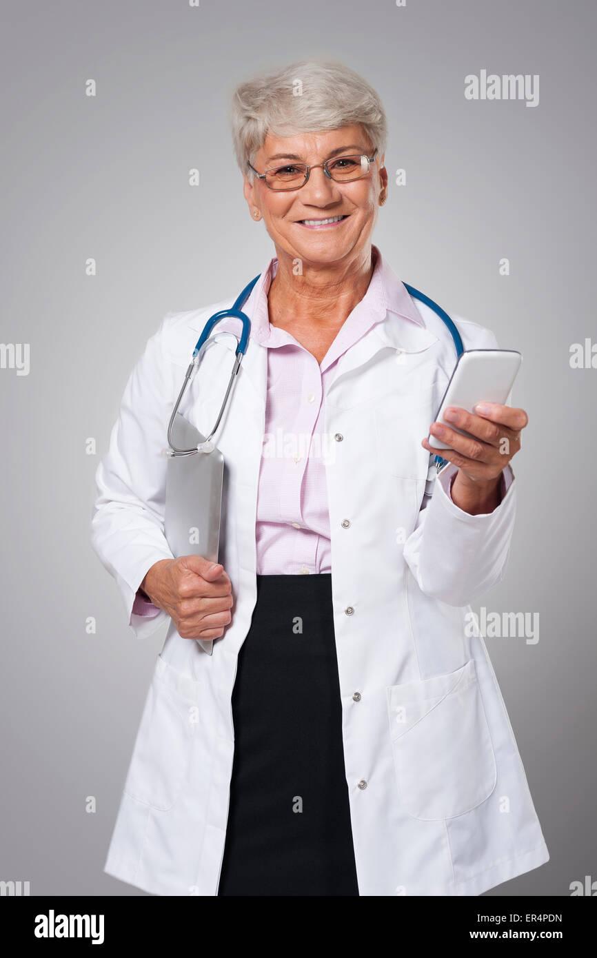 Female senior doctor using from digital technology. Debica, Poland - Stock Image