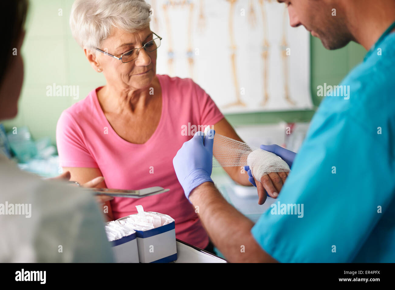 Senior woman with bandage on the hand. Debica, Poland - Stock Image