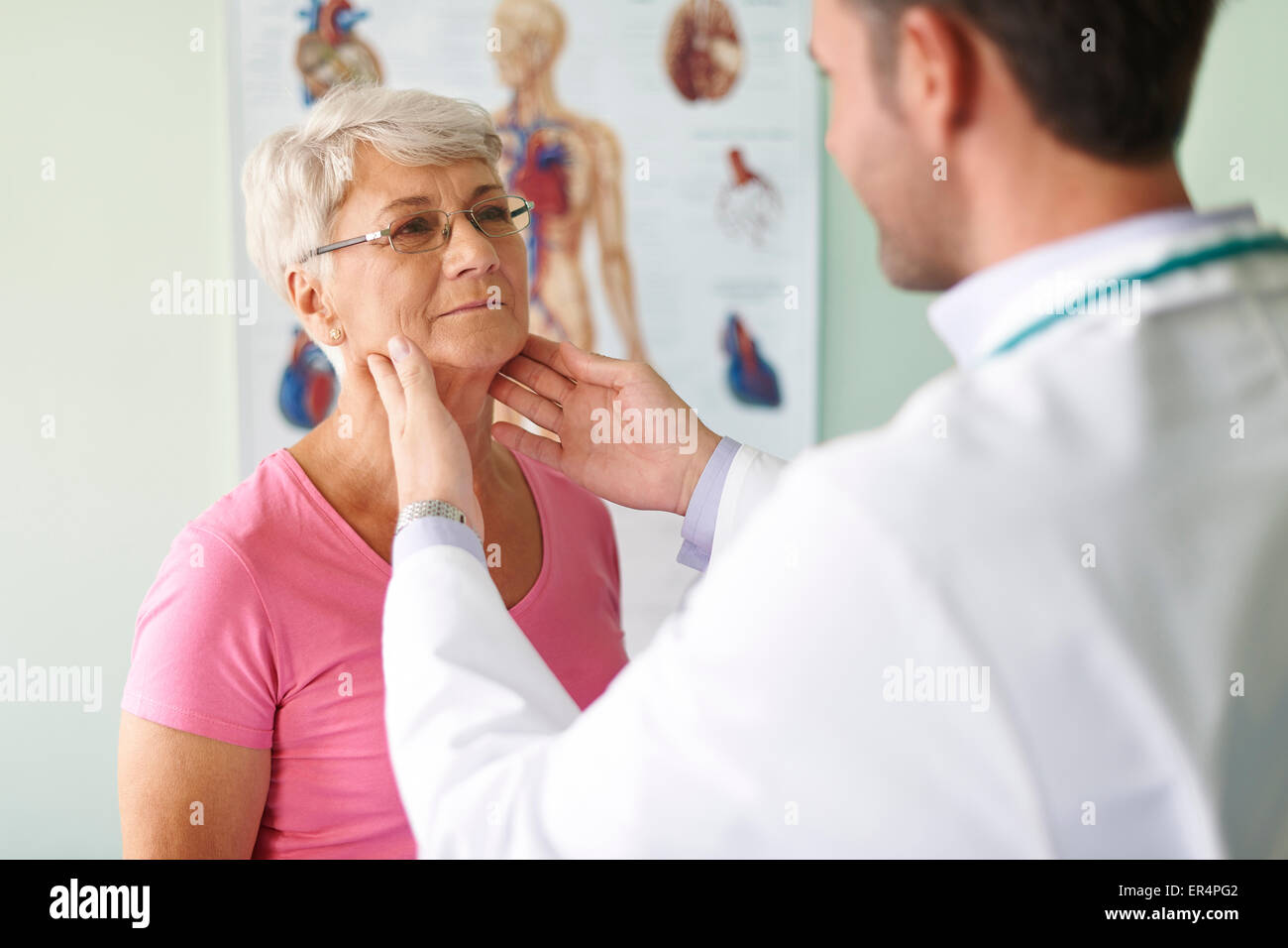 She has problems with sore throat. Debica, Poland - Stock Image