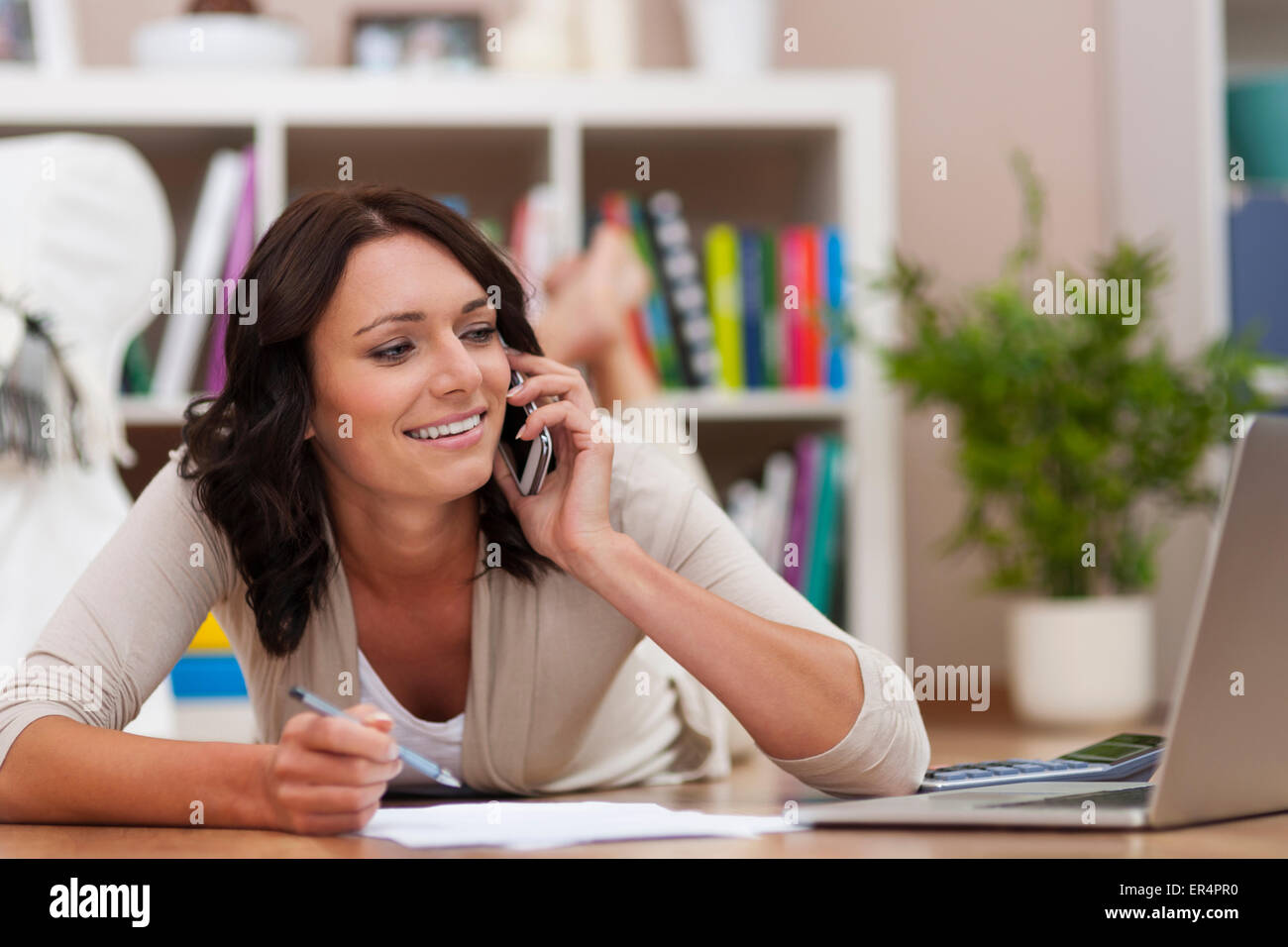 Busy woman with many things to do. Debica, Poland - Stock Image